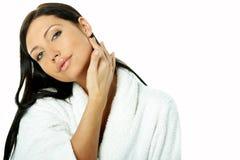 Sensual and Fresh. Portrait of Fresh and Beautiful brunette woman on white background wearing white bathrobe royalty free stock photo