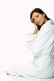 Sensual and Fresh. Portrait of Fresh and Beautiful brunette woman on white background wearing white bathrobe stock photography