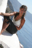 Sensual girl above the roof. Cute girl above the roof in Oia Santorini Greece / Woman Pose royalty free stock photography