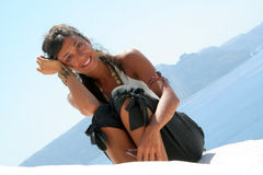 Sensual girl above the roof. In Oia Santorini Greece / Woman Pose royalty free stock photography
