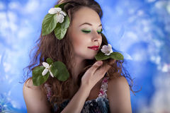 Sensual girl on abstract background from flowers. Glamour make u Stock Photos