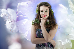 Sensual girl on abstract background from flowers. Glamour make u Royalty Free Stock Image