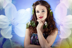 Sensual girl on abstract background from flowers. Glamour make u Royalty Free Stock Photos