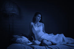 Sensual girl in the bedroom Stock Images