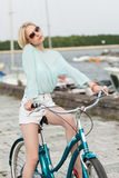 Sensual girl with bicycle Stock Image
