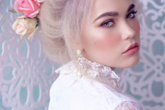 Sensual girl with blond hair in lingerie and accessories Royalty Free Stock Image