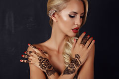 Sensual girl with blond hair with mehendi pattern on hands Royalty Free Stock Image