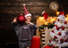 Sensual girl for Christmas. Cute young woman with big red ball christmas toy. Happy woman. Christmas happy. royalty free stock photography