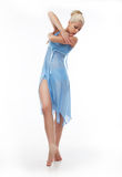 Sensual girl dancer in cyan clothing standing Royalty Free Stock Photos