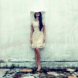 sensual girl in a dress at a wall Stock Photos