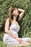 Sensual girl in dry grass Stock Photography