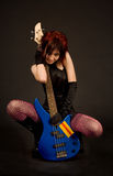Sensual girl with electric guitar Royalty Free Stock Images