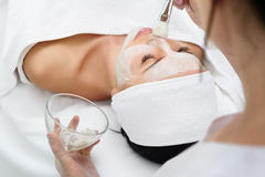 Sensual girl enjoying healthy mask at spa Stock Photos