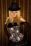 Sensual girl in fashionable corset. Studio shot on glamour background Stock Photography