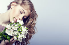 Sensual girl with flowers Stock Images