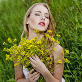 Sensual girl  with flowers Royalty Free Stock Image