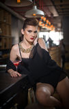 Sensual girl with gorgeous decolletage sitting dreaming at the bar with a drink. Beautiful girl with gorgeous body with makeup. Sensual girl with gorgeous Stock Photography