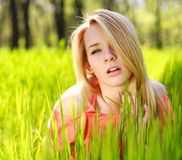 Sensual girl in green grass Royalty Free Stock Photos