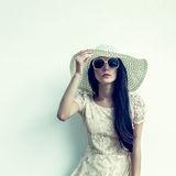 sensual girl in a hat against the wall Stock Photo