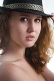 Sensual girl in a hat Stock Images