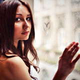 Sensual girl with heart on window Royalty Free Stock Photos