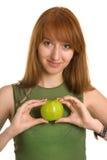 Sensual girl holding apple like a heart Royalty Free Stock Photo