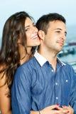 Sensual girl holding boyfriend. Royalty Free Stock Photos