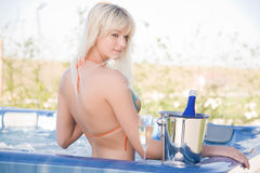 Sensual girl in Jacuzzi. Sensual girl with champagne glass in Jacuzzi stock photos