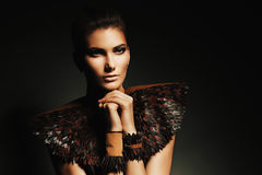 Sensual girl in leather accessory on shoulders Royalty Free Stock Images