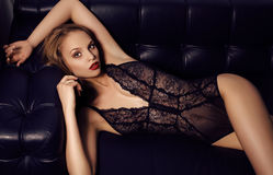 Sensual girl with long dark hair wearing luxurious lace lingerie Stock Photos