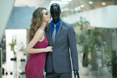 Sensual girl and mannequin Stock Photos