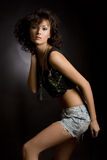 Sensual girl in mini skirt posing in studio Royalty Free Stock Photos