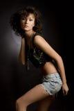 Sensual girl in mini skirt posing in studio. Sensual girl in mini skirt isolated in studio royalty free stock photos