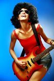 Sensual girl playing on the electric guitar Royalty Free Stock Photo