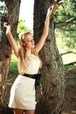Sensual Girl Posing Near The Tree Stock Image