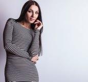 Sensual girl posing. Studio shot on gray background. Stock Image