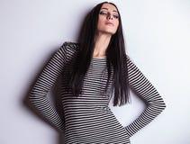 Sensual girl posing. Studio shot on gray background. Royalty Free Stock Image