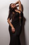 Sensual girl posing. Studio shot on gray background. Stock Photo