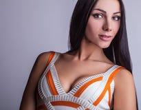 Sensual girl posing. Studio shot on gray background. Stock Photos