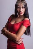 Sensual girl posing. Studio shot on gray background. Royalty Free Stock Photography