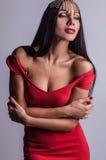 Sensual girl posing. Studio shot on gray background. Royalty Free Stock Photos