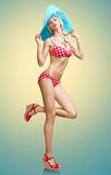 Beautiful woman in red polka dots fashionable swimsuit. PinUp. Playful sexy girl sensually looks, blue hat. Beach body, slim female figure, people, copyspace Royalty Free Stock Photography