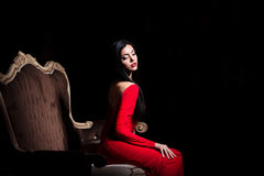 Sensual girl in red dress Stock Images