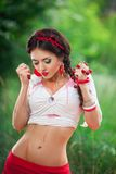 Sensual girl with red lips playing cherry, pin-up Royalty Free Stock Image