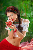 Sensual girl with red lips playing cherry, pin-up Royalty Free Stock Photo