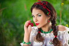 Sensual girl with red lips playing cherry, pin-up Royalty Free Stock Photos