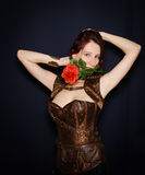 Sensual girl with red rose on mouth Royalty Free Stock Photography
