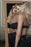 Sensual girl reflected in a mirror Stock Photo