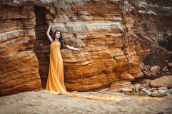 Sensual girl on the rocks Royalty Free Stock Images