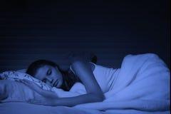 Sensual girl sleeping in the bedroom Stock Image